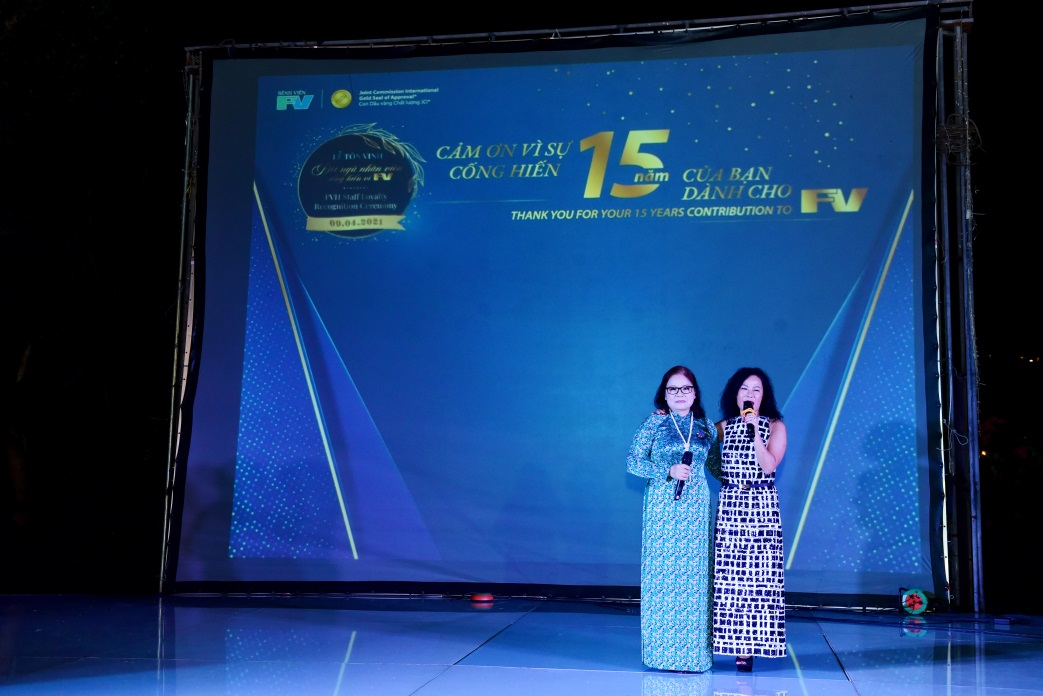 Ms Le Thu - Marketing & Business Development Director and Ms Chau Doai - Sales Department during the honour ceremony