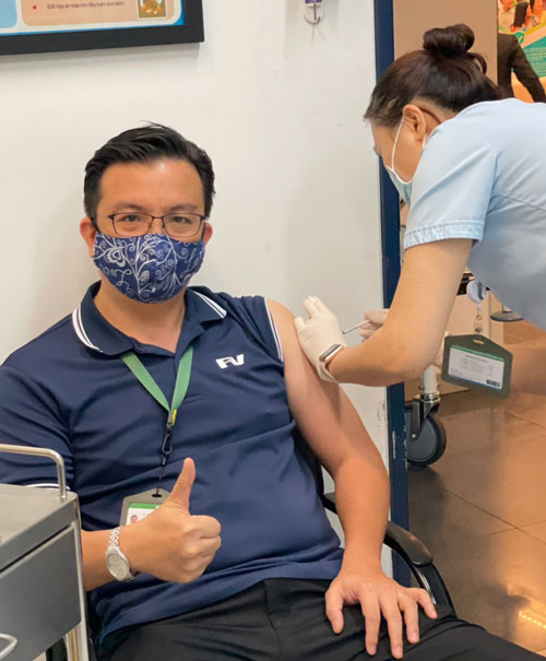 Dr Do Trong Khanh, Medical Director of FV Hospital, receives his Covid-19 vaccine