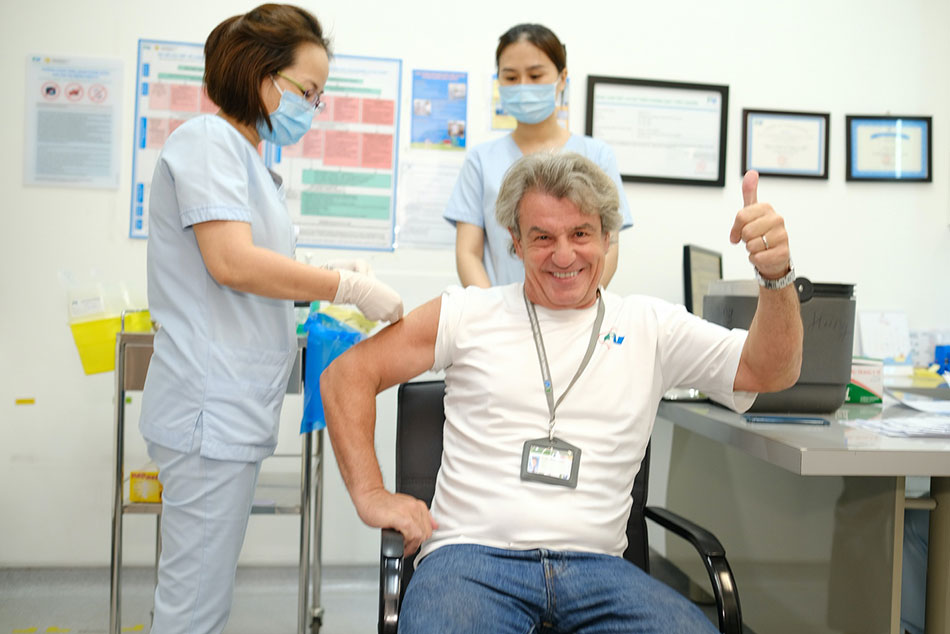 Dr Jean-Marcel Guillion, CEO of FV Hospital, receives his Covid-19 vaccine