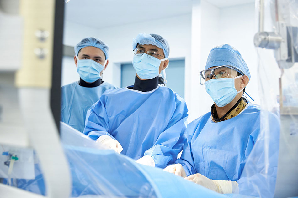 Dr Ho Minh Tuan and the medical team perform surgery in the Cardiac Cathlab