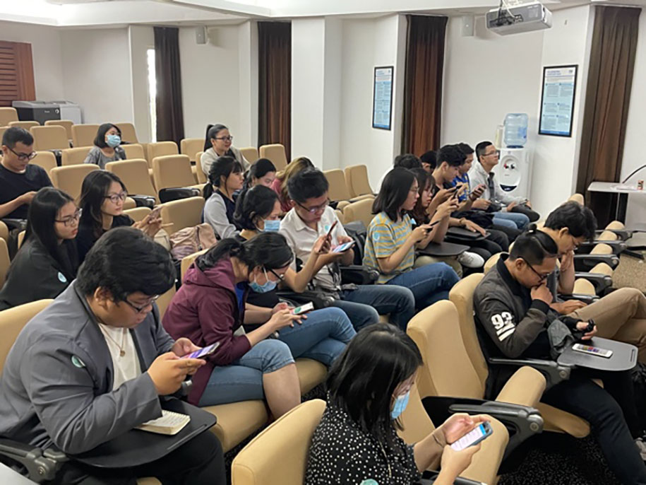 The students were doing online final test on Smartphone